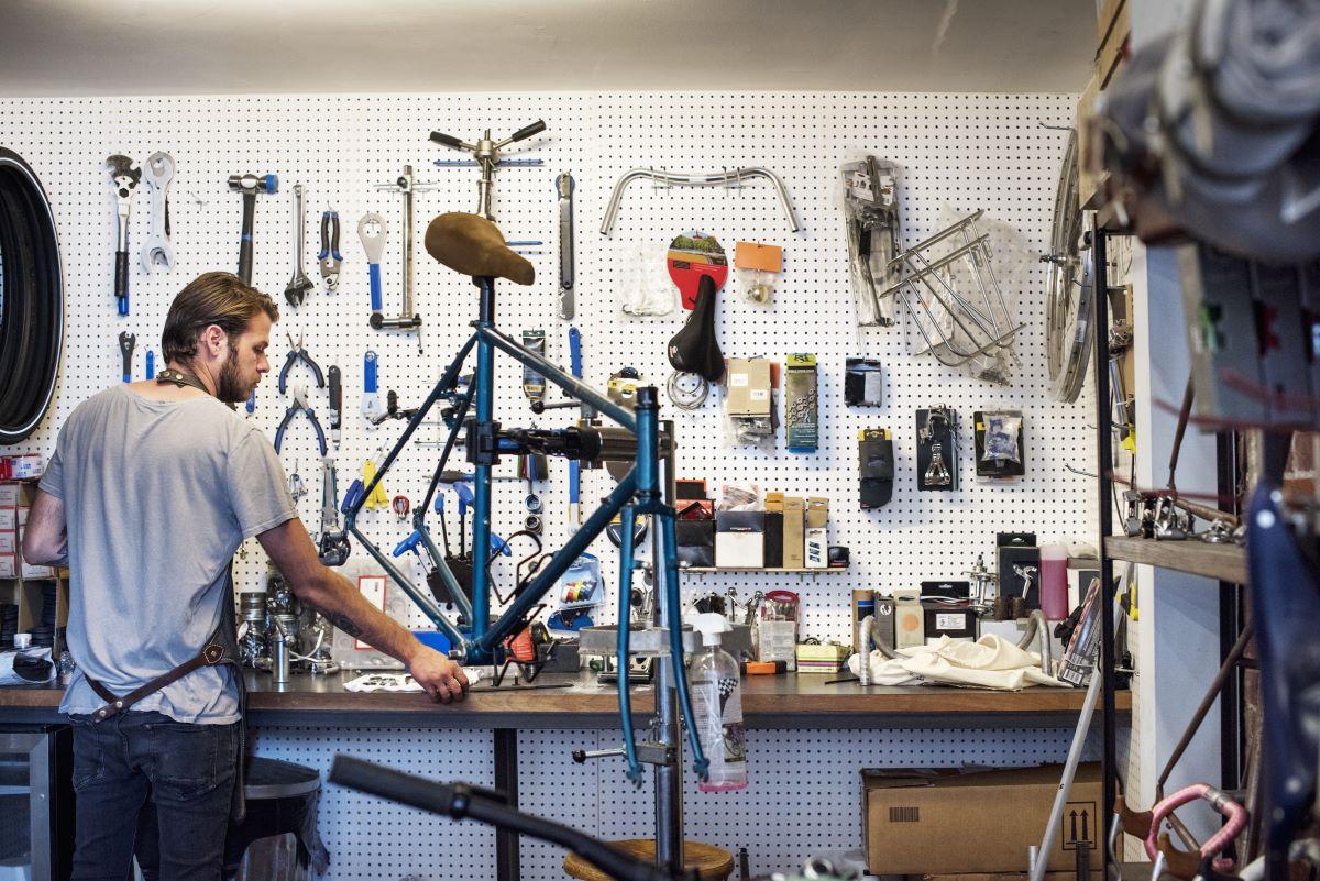 man working in bikeshop