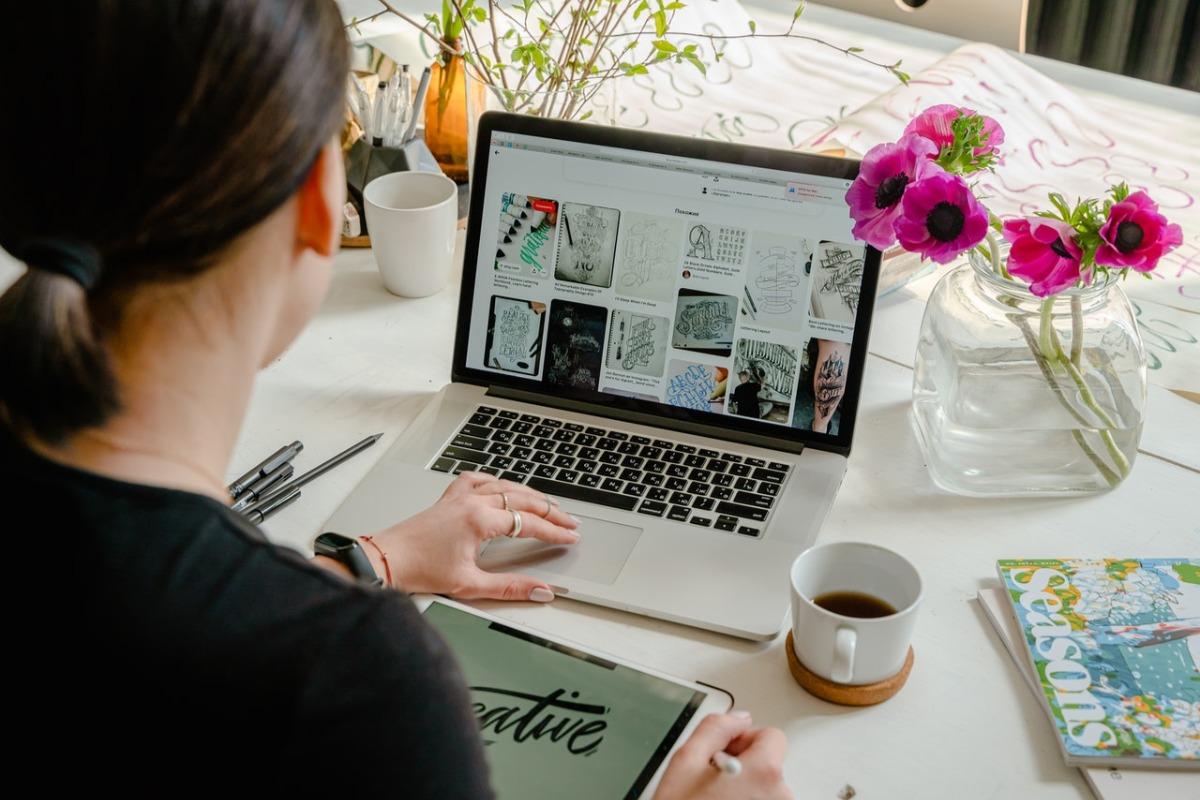 woman looking at artworks