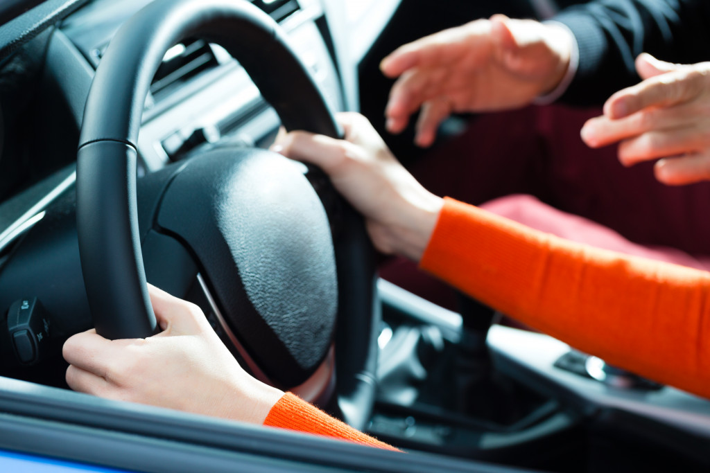 hands on the steering wheel of a car
